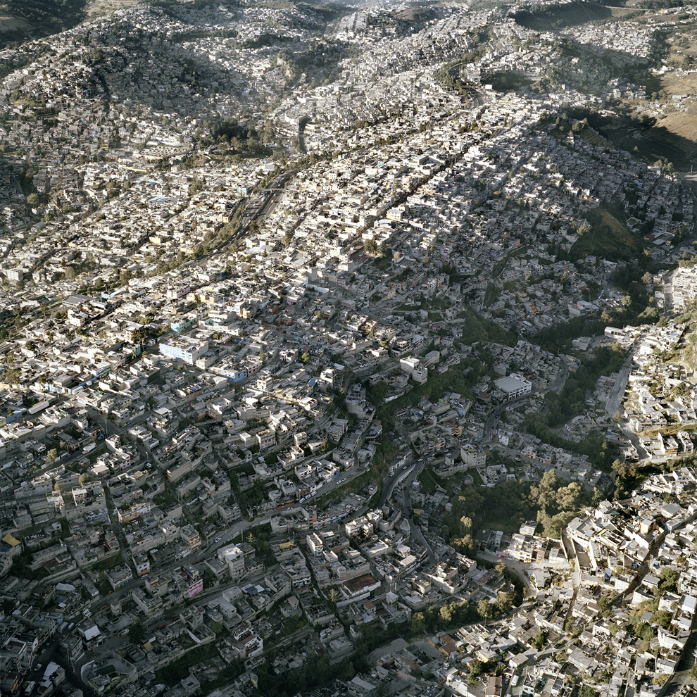 MEXICO CITY, MEXICO - UNDATED: Aerial view of Mexico City, one of the most densely populated places in the world in Mexico City, Mexico. These amazing aerial shots capture Mexico City's ever increasing expansion. According to Forbes there are a staggering 25,400 people squashed into each square mile of the sprawling metropolis. Photographer Pablo Lopez Luz, who took the snaps from a tiny two-person plane, said the sheer size of his native city still blows him away when documenting its constant expansion. PHOTOGRAPH BY Pablo Lopez Luz / Barcroft Media UK Office, London. T +44 845 370 2233 W www.barcroftmedia.com USA Office, New York City. T +1 212 796 2458 W www.barcroftusa.com Indian Office, Delhi. T +91 11 4053 2429 W www.barcroftindia.com